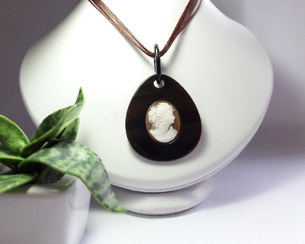 Pendant with antique cameos and black horn
